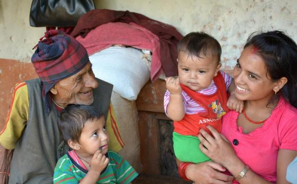 Source - © 2013 Valerie Caldas, Courtesy of Photoshare. Children with their mother and grandfather in Baglung District, Nepal.