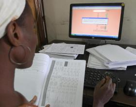 © 2012 Akintunde Akinleye/NURHI, Courtesy of Photoshare. Abiola Olugbade, a family planning data input officer, works in a room at the Measurement, Learning and Evaluation (MLE) office in the central business district of Nigeria's capital Abuja.
