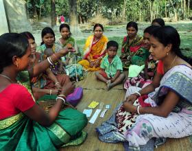 Source - © 2016 Tushar Sharma, Courtesy of Photoshare. Description - A rural health worker teaches women about the IUD and other contraceptive methods at a remote village in Kushamandi, South Dinajpur, West Bengal, India.