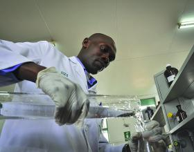 An analyst at the National Quality Control Laboratory conducts a test on a pharmaceutical sample. Photo Credit: Tobin Jones, Chemonics. Courtesy of USAID OHA Flickr.