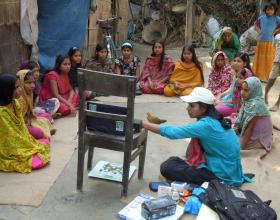Description-Info Lady shows video to adolescent girls. Source-© 2012 Cassandra Mickish/CCP, Courtesy of Photoshare.