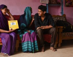 Source - © 2016 Arvind Jodha/UNFPA, Courtesy of Photoshare. Description - An Accredited Social Health Activist (ASHA) in India explains the various family planning methods to a couple, as the young bride shies away.