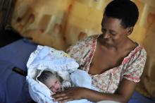 Source - © 2017 Riccardo Gangale, Courtesy of Photoshare. Description - Grace Nukayisire with her 1-day-old baby Ineza at the maternity ward in Manyange health center in Nyamata, Rwanda.