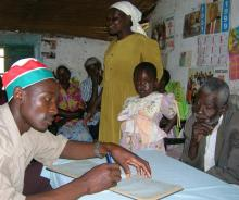 A field worker in Vihiga, Kenya registers HIV/AIDS orphans