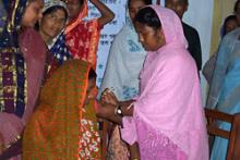 Description - A health worker administers a Somazet injection for family planning at a community health clinic in Islampur union, Rajbari district, Bangladesh. Source - © 2004 Ahsanul Kabir, Courtesy of Photoshare.