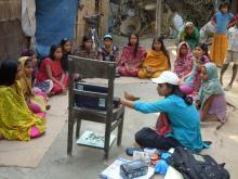 Description-Info Lady shows video to adolescent girls. Source-© 2012 Cassandra Mickish/CCP, Courtesy of Photoshare.