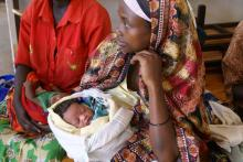 Source-Elena Ghanotakis.  Description-Mother and baby at clinic in Rwanda.