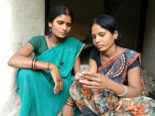 Source - Satish Srivastava/Catholic Relief Services. An ASHA uses a CommCare application on mobile phone to counsel her pregnant client.