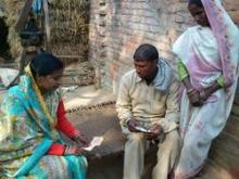 Source - © 2011 JHUCCP, Courtesy of Photoshare. Description - A couple in Uttar Pradesh, India, receives family planning counseling from RESPOND Project staff.